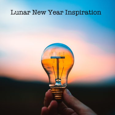 lightbulb and text reading lunar new year inspiration