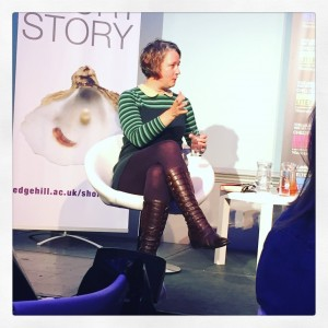 claire fuller sitting in a chair and talking, cheltenham literature
