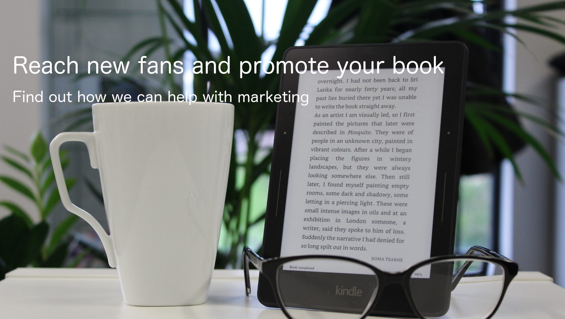 kindle, glasses and coffee mug
